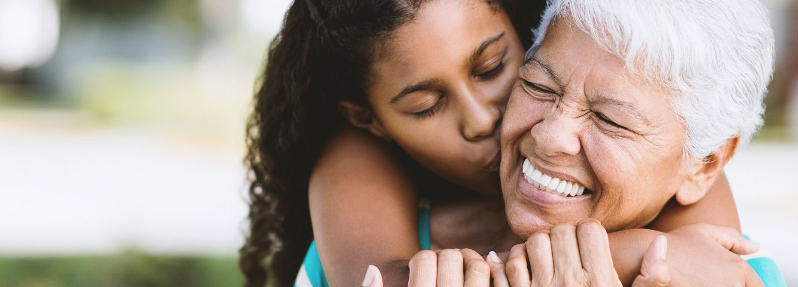 Young girl hugging an older woman