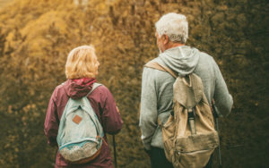 Older woman and man hiking