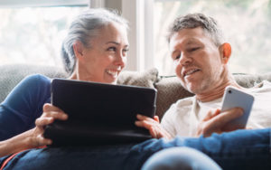 Older woman and older man looking at a tablet