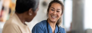 Medical professional smiling at a patient