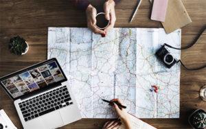 Travel - map, laptop