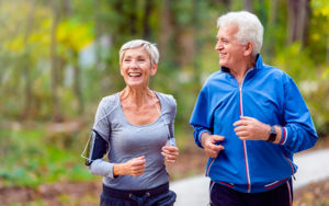 Older man and woman running